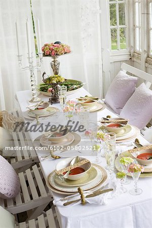 Dining table prepared for meal Stock Photo - Premium Royalty-Free, Image code: 6102-05802521