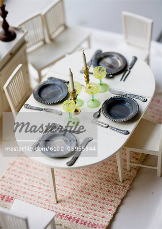 Dining table in dollhouse Stock Photo - Premium Royalty-Free, Image code: 6102-05955944