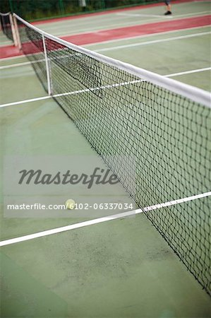 High angle view of net and tennis ball Stock Photo - Premium Royalty-Free, Image code: 6102-06337034