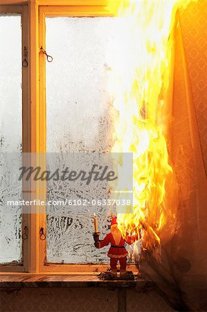 Burning curtain at home Stock Photo - Premium Royalty-Free, Image code: 6102-06337038
