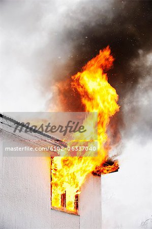 Flames coming out of window Stock Photo - Premium Royalty-Free, Image code: 6102-06337040