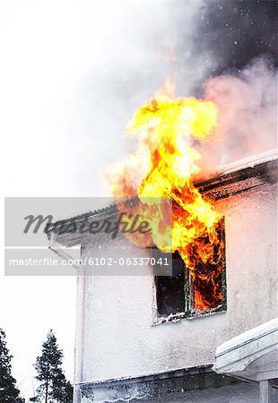 Flames coming out of window Stock Photo - Premium Royalty-Free, Image code: 6102-06337041