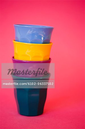Stack of multicolored mugs, studio shot Stock Photo - Premium Royalty-Free, Image code: 6102-06337102