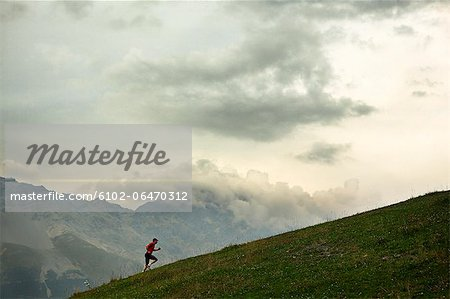 A man jogging in the mountains, Italy. Stock Photo - Premium Royalty-Free, Image code: 6102-06470312