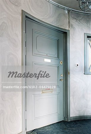 Close entrance door at home Stock Photo - Premium Royalty-Free, Image code: 6102-06471028