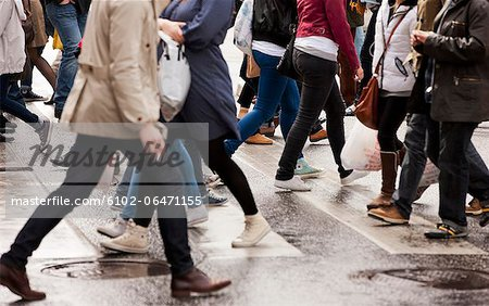 Close-up of people on zebra crossing