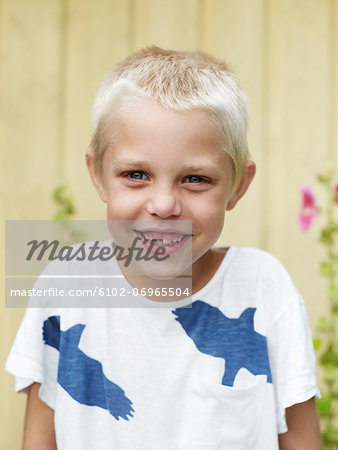 Portrait of smiling boy Stock Photo - Premium Royalty-Free, Image code: 6102-06965504