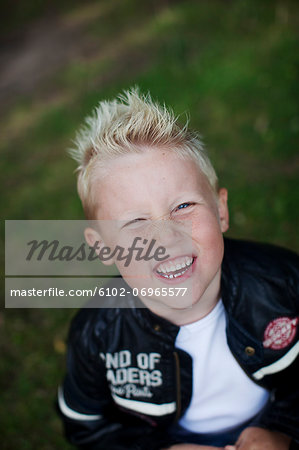 Portrait of smiling boy Stock Photo - Premium Royalty-Free, Image code: 6102-06965577