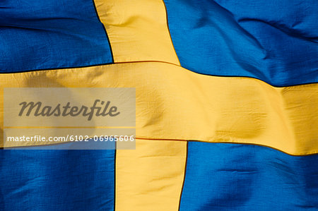 Swedish flag, close-up Stock Photo - Premium Royalty-Free, Image code: 6102-06965606