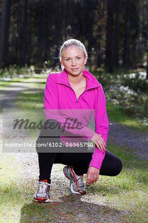Smiling young woman Stock Photo - Premium Royalty-Free, Image code: 6102-06965790