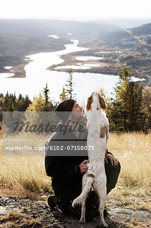 Man with dog Stock Photo - Premium Royalty-Free, Image code: 6102-07158073
