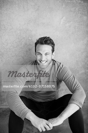 Portrait of smiling mid adult man Stock Photo - Premium Royalty-Free, Image code: 6102-07158075