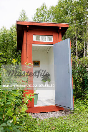 Open outhouse Stock Photo - Premium Royalty-Free, Image code: 6102-07158182