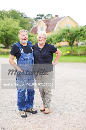 Senior couple standing together Stock Photo - Premium Royalty-Free, Image code: 6102-07158355