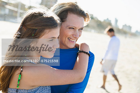 Mother with daughter on beach Stock Photo - Premium Royalty-Free, Image code: 6102-07521598