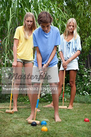 Teenager playing croquet Stock Photo - Premium Royalty-Free, Image code: 6102-07602733
