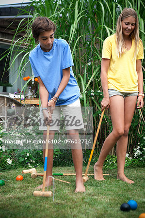 Teenager playing croquet Stock Photo - Premium Royalty-Free, Image code: 6102-07602734