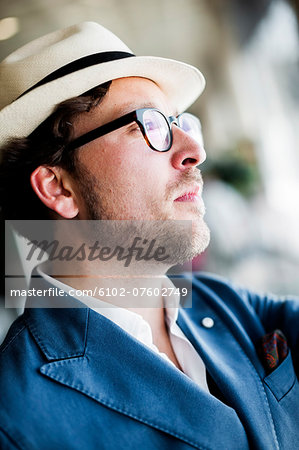 Young man wearing hat, Spain Stock Photo - Premium Royalty-Free, Image code: 6102-07602749