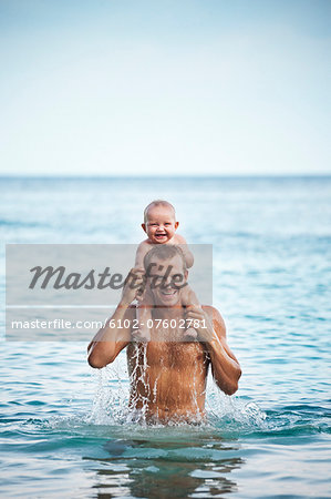 Father with baby in sea, Thailand Stock Photo - Premium Royalty-Free, Image code: 6102-07602781