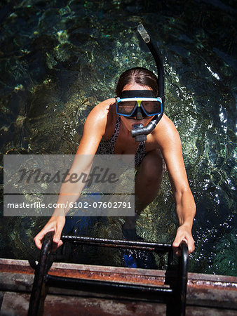 Diving woman, Thailand Stock Photo - Premium Royalty-Free, Image code: 6102-07602791