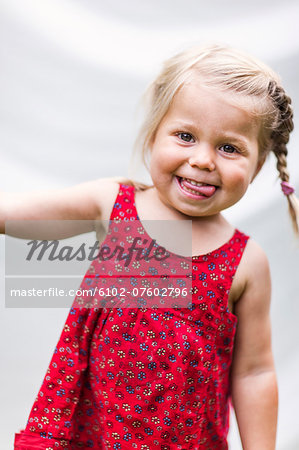 Portrait of smiling girl, Sweden Stock Photo - Premium Royalty-Free, Image code: 6102-07602796