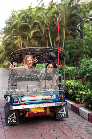 Young women in rickshaw, Bangkok, Thailand Stock Photo - Premium Royalty-Free, Image code: 6102-07768959