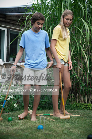 Teenagers playing croquet in garden, Sweden Stock Photo - Premium Royalty-Free, Image code: 6102-07789510