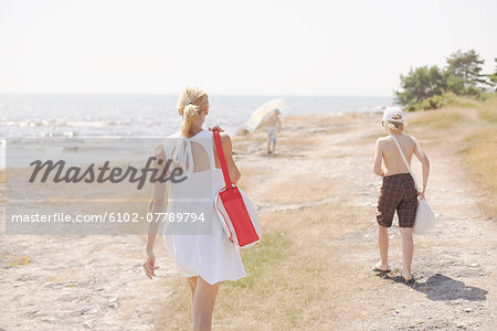 Mother walking with two sons, rear view Stock Photo - Premium Royalty-Free, Image code: 6102-07789794
