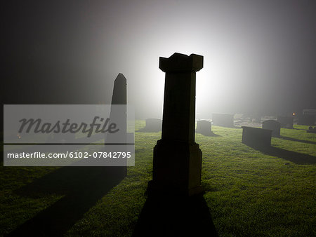 Cemetery at night Stock Photo - Premium Royalty-Free, Image code: 6102-07842795