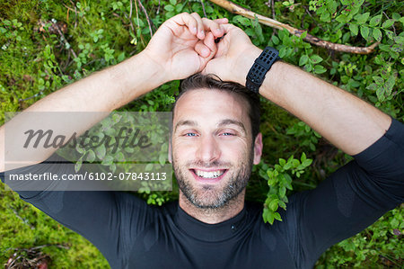 Tired runner in forest Stock Photo - Premium Royalty-Free, Image code: 6102-07843113