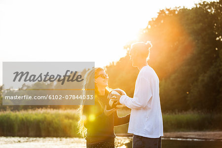 Young couple with football Stock Photo - Premium Royalty-Free, Image code: 6102-07844033