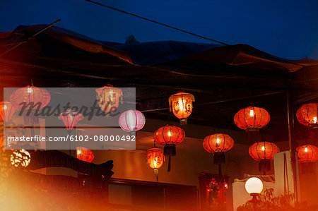 Paper lanterns at night Stock Photo - Premium Royalty-Free, Image code: 6102-08000492