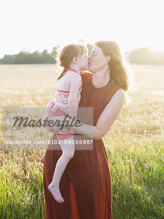 Mother with daughter Stock Photo - Premium Royalty-Free, Image code: 6102-08000887