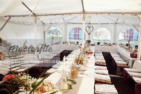 Wedding reception in tent Stock Photo - Premium Royalty-Free, Image code: 6102-08001087