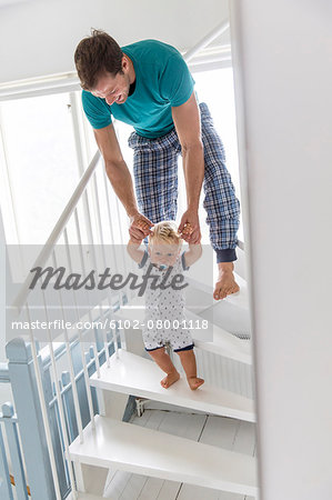 Father with son on stairs Stock Photo - Premium Royalty-Free, Image code: 6102-08001118