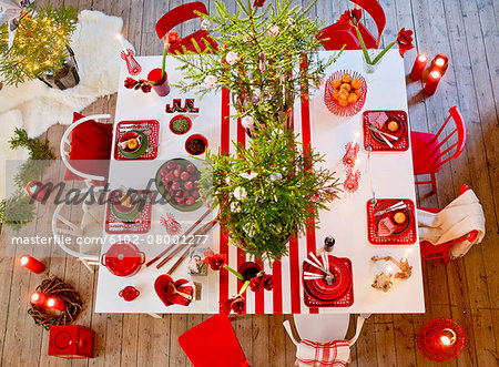 Christmas table Stock Photo - Premium Royalty-Free, Image code: 6102-08001277