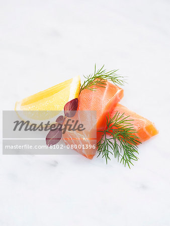 Salmon and lemon on white background Stock Photo - Premium Royalty-Free, Image code: 6102-08001396