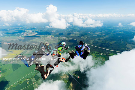 Sky-divers in air Stock Photo - Premium Royalty-Free, Image code: 6102-08001437