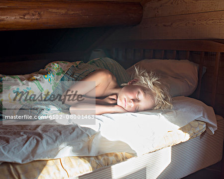 Girl sleeping Stock Photo - Premium Royalty-Free, Image code: 6102-08001463