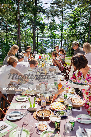 Family having meal outdoors Stock Photo - Premium Royalty-Free, Image code: 6102-08120093
