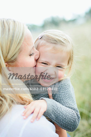 Mother with daughter on meadow Stock Photo - Premium Royalty-Free, Image code: 6102-08120410