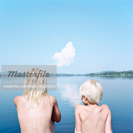 Boy and girl looking at water Stock Photo - Premium Royalty-Free, Image code: 6102-08120531