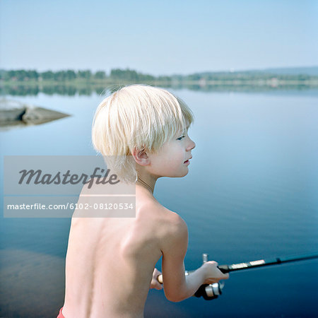 Boy fishing Stock Photo - Premium Royalty-Free, Image code: 6102-08120534