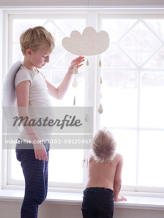 Boys playing together Stock Photo - Premium Royalty-Free, Image code: 6102-08120867