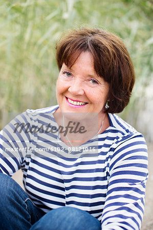 Smiling mature woman Stock Photo - Premium Royalty-Free, Image code: 6102-08121016