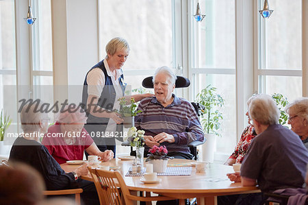 Senior people having coffee in care home Stock Photo - Premium Royalty-Free, Image code: 6102-08184218