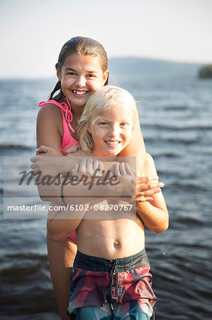 Brother and sister at sea Stock Photo - Premium Royalty-Free, Image code: 6102-08270767