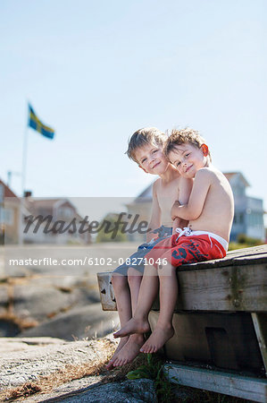 Boys sitting  together Stock Photo - Premium Royalty-Free, Image code: 6102-08271046