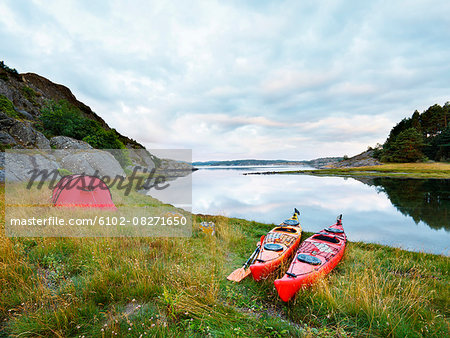 Canoes at sea Stock Photo - Premium Royalty-Free, Image code: 6102-08271650