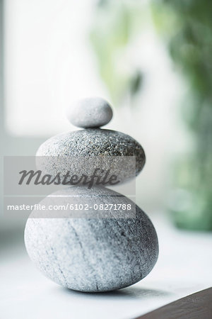 Stack of pebbles Stock Photo - Premium Royalty-Free, Image code: 6102-08271788